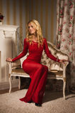 Romantic portrait of a beautiful blonde lady in a red dress Stock Photo