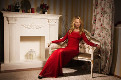 Romantic portrait of a beautiful blonde lady in a red dress Stock Image