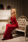 Romantic portrait of a beautiful blonde lady in a red dress Royalty Free Stock Images
