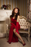 Romantic portrait of a beautiful lady in a red dress Royalty Free Stock Photography
