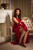 Romantic portrait of a beautiful lady in a red dress Royalty Free Stock Photos