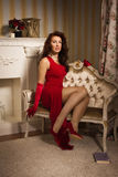Romantic portrait of a beautiful lady in a red dress Stock Photography