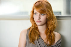 Romantic portrait of a beautiful redhead girl. Romantic portrait of a beautiful redhead girl, wearing gray top stock image