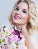 Romantic portrait of beautiful young woman with flowers over whi. Te background. Close up Royalty Free Stock Images