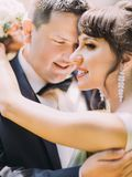 ROmantic portrait of the charming bride hugging groom. ROmantic portrait of the charming bride hugging groom Stock Photography