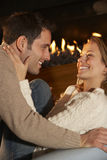 Romantic portrait couple in front of fire Stock Photography