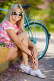 Romantic portrait of a girl with a bicycle Stock Photography