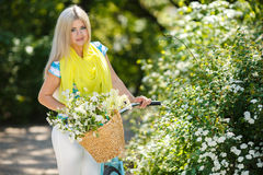 Romantic portrait of a girl with a bicycle Royalty Free Stock Photos
