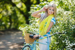 Romantic portrait of a girl with a bicycle Stock Image