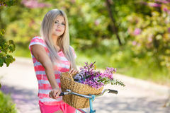 Romantic portrait of a girl with a bicycle Royalty Free Stock Image