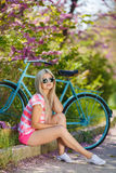 Romantic portrait of a girl with a bicycle Royalty Free Stock Images