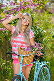 Romantic portrait of a girl with a bicycle Stock Photo