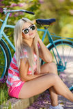 Romantic portrait of a girl with a bicycle Royalty Free Stock Photography