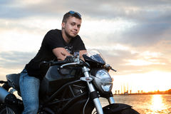 Romantic portrait handsome biker man in sunglasses Royalty Free Stock Photography