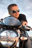 Romantic portrait handsome biker man in sunglasses Stock Photos