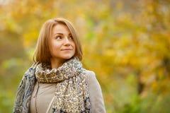 Romantic portrait of pensive girl walking in autumn park Royalty Free Stock Photos