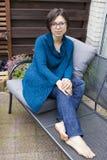 Romantic portrait of trendy girl sitting on garden bench. Royalty Free Stock Photos