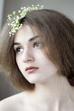 Romantic portrait of young beautiful girl. With natural makeup and flowers Stock Image