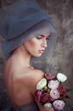 Romantic portrait of young lady in turban with ranunculus Stock Photography