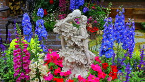 Romantic pose figurines surrounded by exotic flowers stock video