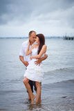 Romantic pose of married couple at the sea Stock Images