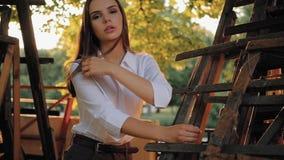 Romantic posing elegant confident girl nature park. Romantic posing. Elegant, confident girl. Nature park Sun beams stock video footage