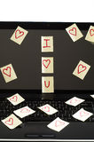 Romantic post it notes. Post it notes with harts  scatered over  computer screen  with i love you Royalty Free Stock Image