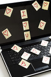 Romantic post it notes. Post it notes with harts  scatered over  computer screen  with i love you Stock Photos