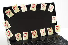 Romantic post it notes. Post it notes with harts  scatered over  computer screen  with i love you Stock Image