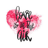 Romantic poster with hand lettering and heart. Romantic poster with lettering and fingerprint heart. Black handwritten phrase Love is in the air and pink Stock Images