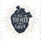 Romantic poster with human heart and inspiring lettering. Hand drawn textured romantic poster with human heart and inspiring lettering on white background Royalty Free Stock Photography