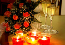 Romantic preparations. Roses, champagne and candles. A nice romantic scene Stock Photo