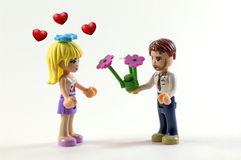 Romantic present. Couple of toys in a romantic scene Stock Images