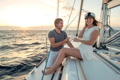 Romantic proposal scene on yacht stock images