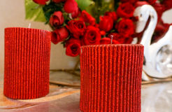 Romantic red candles and flowers. Romantic red candles, flowers and decorations. Signifying love, passion and togetherness Royalty Free Stock Image