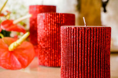Romantic red candles and flowers. Romantic red candles, flowers and decorations. Signifying love, passion and togetherness Stock Photography