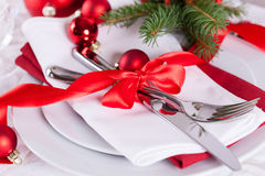 Romantic red Christmas table setting Stock Photo