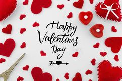 Romantic red flat lay composition on white background. Heart top view. Happy Valentines day hand lettering greeting card. Love you royalty free stock photography
