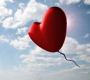 Romantic Red Heart On Cloudy Sky Stock Photo