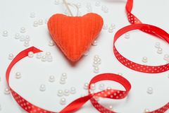 Romantic red heart on a white background for a card. Romantic red heart on a white background for a greeting card stock photography
