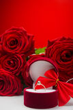 Romantic red roses with golden ring Royalty Free Stock Images