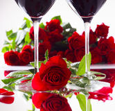 Romantic red roses with two glasses of red wine Stock Photo