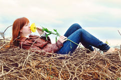 Romantic redhead girl. With autumn flower royalty free stock images