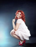 Romantic redhead woman posing. Royalty Free Stock Image
