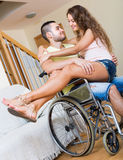 Romantic relationships in invalid chair Stock Photos