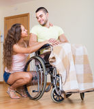 Romantic relationships in invalid chair Stock Photography