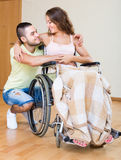 Romantic relationships in invalid chair Stock Photo