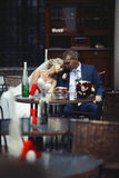Romantic relaxed newlywed couple sitting at restaurant table Royalty Free Stock Photos