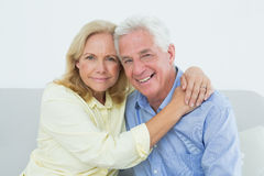 Romantic relaxed senior couple at home Stock Photography