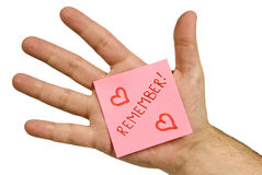 Romantic REMEMBER Note On Hand royalty free stock image